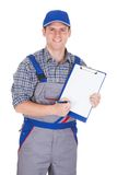Male construction worker holding clipboard Stock Images