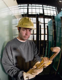 Male Construction Worker with large pipe wrench Royalty Free Stock Photography