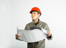 Male construction worker and sketching blueprints Royalty Free Stock Images