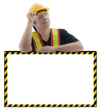 Male construction worker with Standard construction safety equip. Ment is presenting empty banner isolated on white background Stock Photography