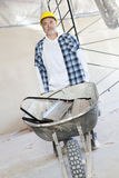 Male construction worker standing with a wheelbarrow Stock Photos