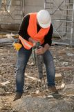 Male construction worker using jackhammer. Outdoors Stock Photos