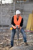 Male construction worker using jackhammer. Outdoors Stock Photography