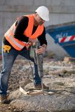 Male construction worker using jackhammer. Outdoors Royalty Free Stock Photos