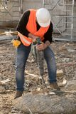 Construction worker using jackhammer. Male construction worker using jackhammer. Vertical shot Stock Image