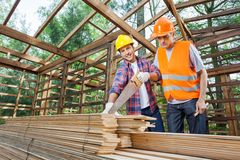Male Construction Workers Working At Site Royalty Free Stock Photo