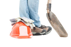 Male constructor with work tool and safety equipment. In closeup isolated on white studio background Royalty Free Stock Photography
