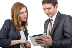 Male consultant explains features of electronic. Devise to female customer Portrait of young men and women keeping tablet PC touching screen discussing its Stock Images