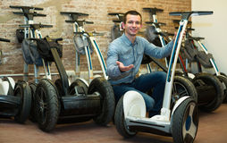 Male consultant in segways rental agency Stock Images