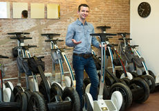 Male consultant in segways rental agency Stock Image