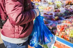 Male consumer at an open street market shopping fruit and vegetables. Street market. Helthy food. Fruits Stock Images