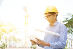 Male contractor engineer reading on tablet pc Stock Photos