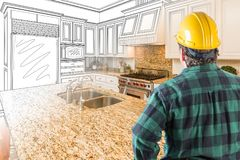 Male Contractor with Hard Hat and Tool Belt Looking At Custom Ki. Tchen Drawing Photo Combination On White Royalty Free Stock Image