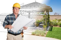 Male Contractor With House Plans Wearing Hard Hat In Front of Cu. Stom Pergola Patio Covering Drawing Photo Combination Royalty Free Stock Image