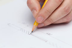 Male contractor making changes to blueprint. Building, developing, consrtuction and architecture concept - male contractor making changes to blueprint Stock Photos