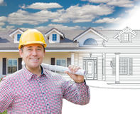 Male Contractor Wearing Hard Hat In Front of House Drawing Grada. Tion Into Photograph Royalty Free Stock Photos
