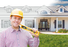 Male Contractor Wearing Hard Hat In Front of House Drawing Grada. Male Contractor Wearing Hard Hat In Front of a House Drawing Gradation Into Photograph Royalty Free Stock Photography