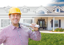 Male Contractor Wearing Hard Hat In Front of House Drawing Grada. Male Contractor Wearing Hard Hat In Front of a House Drawing Gradation Into Photograph Stock Photo