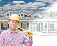 Male Contractor Wearing Hard Hat In Front of House Drawing Grada. Tion Into a Photograph Royalty Free Stock Photos