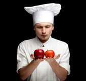 Male cook with apples Royalty Free Stock Image