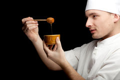Male cook with bowl of honey Royalty Free Stock Images