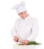 Male cook cutting dill Royalty Free Stock Photos