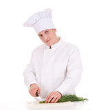 Male cook cutting dill Stock Photos