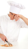 Male cook cutting onion Royalty Free Stock Images