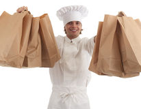 Male cook with ecological paper bags Stock Image