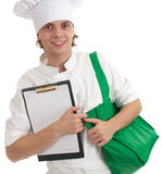 Male cook with green bag and blank clipboard Stock Photos