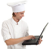 Male cook with laptop Stock Photo