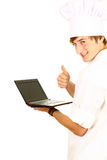Male cook with laptop and thumb up Royalty Free Stock Image