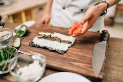 Free Male Cook Making Sushi On Wooden Table, Asian Food Stock Photography - 108224682