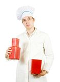 Male cook with packages Stock Images