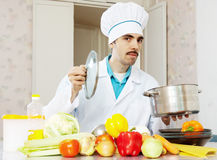 Male cook with pan and vegetables Royalty Free Stock Photo