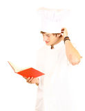 Male cook reading book Stock Photography