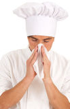 Male cook snotty, blowing her nose Royalty Free Stock Photo