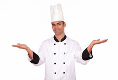 Male cook standing with palms open Stock Photos
