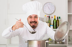 Male cook tasting food Stock Images