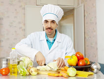 Male cook  with vegetables Royalty Free Stock Images