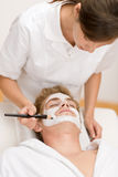 Male cosmetics - facial mask. In luxury spa center Stock Photos