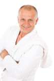 Male cosmetics - mature man in white bathrobe Royalty Free Stock Images