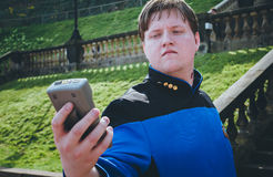 Male cosplayer in Star Trek costume. Scarborough, UK - April 09, 2017: Male cosplayer dressed as a character from `Star Trek` poses with a tricorder at the Sci Stock Photography