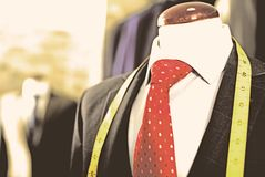 Male costume on a mannequin in men clothing store Royalty Free Stock Images