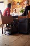 A male couple check in at a boutique hotel, low angle view Royalty Free Stock Photo