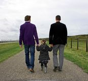 Male couple with child Royalty Free Stock Image