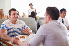 Male Couple Enjoying Breakfast In Hotel Restaurant Stock Photos