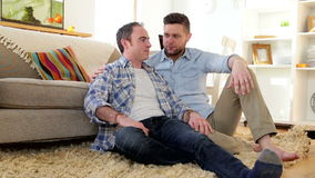 Male couple talking at home stock footage