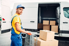 Male courier in uniform work with cargo, back view Stock Photo