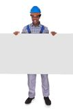 Male craftsman with blank card Royalty Free Stock Images